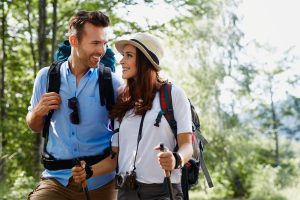 Happy backpackers couple hiking